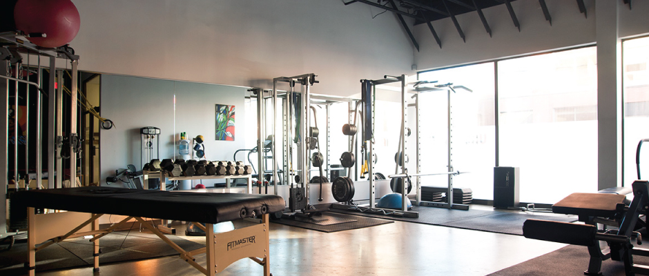 Bright gym with training equipment
